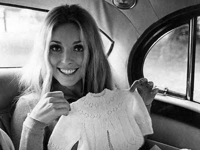 platinumfan-20110429123412-sharon_tate_with_baby_clothes-original